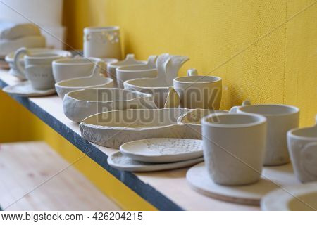 Unfinished Clay Pots On Shelves As Part Of A Ceramic Pottery Workshop. Creative Studio Potter. Diffe