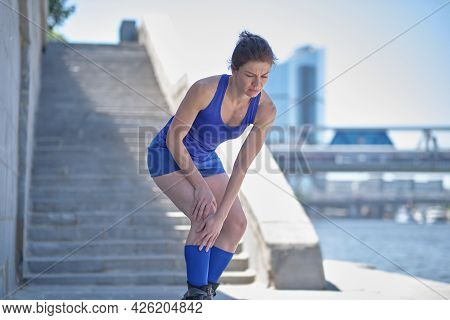 Health And Fitness Concept Accident When Training Female Runner Leg And Muscle Pain During Running O