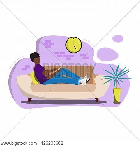 African Male Character Sitting On The Couch With A Laptop And Working In The Living Room. Man Sittin