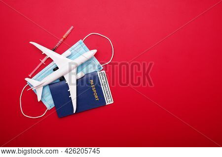 Syringe, Toy Plane, Medical Mask And Passport With Certificate Of Vaccination With Text 'covid-19 Va