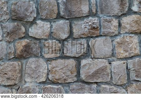 Masonry Rock Wall Texture. Texture Of A Stone Wall. Part Of Old Castle Stone Wall Background. Grey S