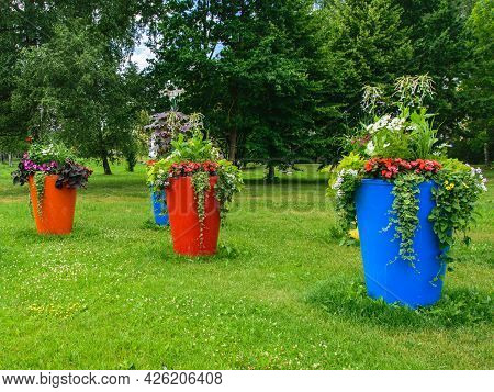 Urban Landscapening.large Flowerpots Adorning The City Park.
