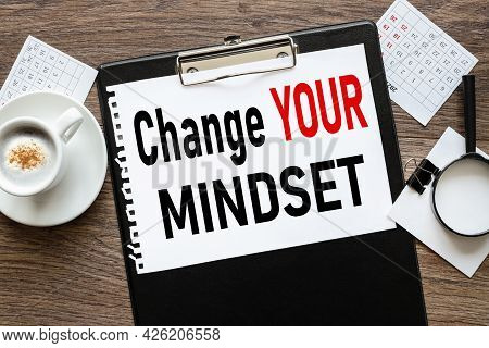 Change Your Mindset. Text On Wood Table, On White Paper