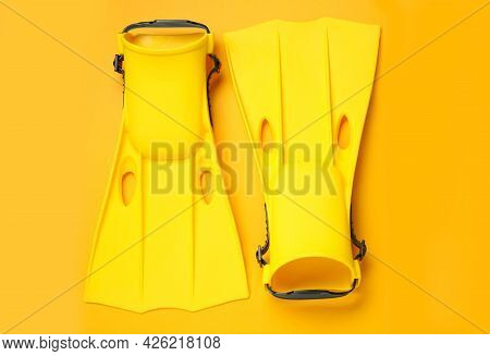Pair Of Flippers On Yellow Background, Flat Lay