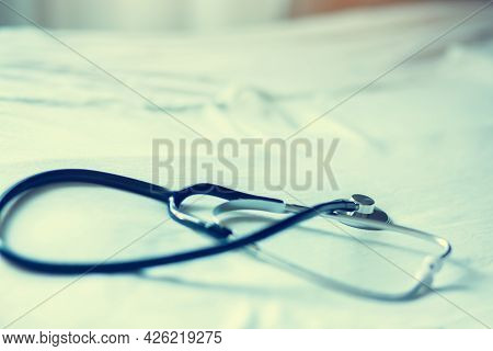 Selective Focus To Black Stethoscope. Stethoscope For Doctor Checkup On Health Medical Laboratory.