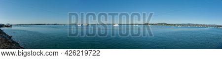 Blue Panorama Across Harbour From Tauranga City Waterfront. New Zealand.
