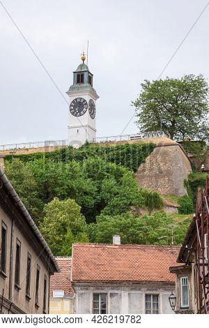 Clocktower Of The Petrovaradin Fortress In Novi Sad, Serbia Seen From The Lower Town Of Petrovaradin
