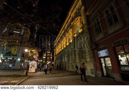 Novi Sad, Serbia - November 18, 2019: Selective Blur On People Walking With Speed Blur By The Name O