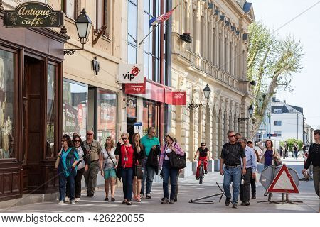 Vukovar, Croatia - April 20, 2018: Group Of Tourists, In Crowd, Visiting Ulica Franja Tudjama In The