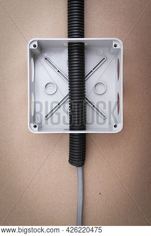 White Electrical Junction Box With Wires On Beige Background