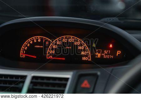 Novosibirsk, Russia - June 29, 2021: Toyota Vitz, Car Dashboard With Orange  Backlight: Odometer, Sp