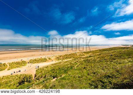 Sunny Cliffs and beach at Blackhall Rocks and Cromdon Dene Beach