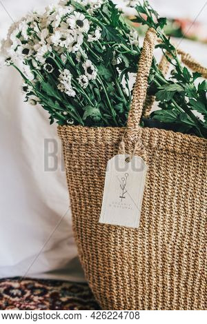 Woven basket full with White Anemone flowers