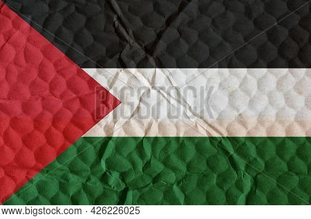 Flag Of State Of Palestine On An Uneven Textured Surface. The National Flag Of The Country Located I