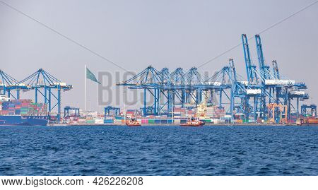 Gantry Cranes Unload Container Ships On A Sunny Summer Day. Jeddah Port, Saudi Arabia