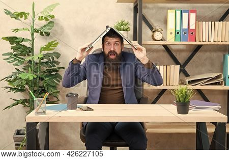 Bearded Man In Formalwear Hold Laptop Computer On Head Keeping Eyes And Mouth Open At Workplace In M