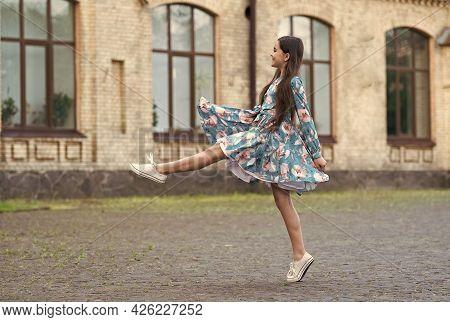 Girl Summer Dress Flutters In Motion Urban Background, Making Step Concept