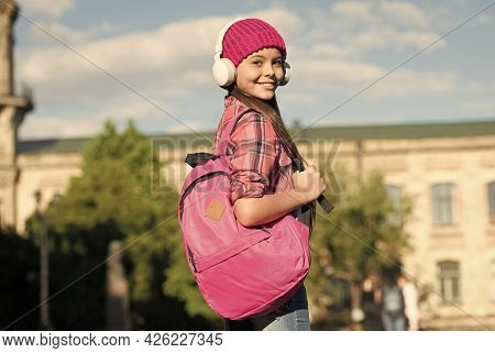 Instilling A Sense Of Wanderlust. Happy Girl Travel With Backpack Urban Outdoors. Audio Library. Tra