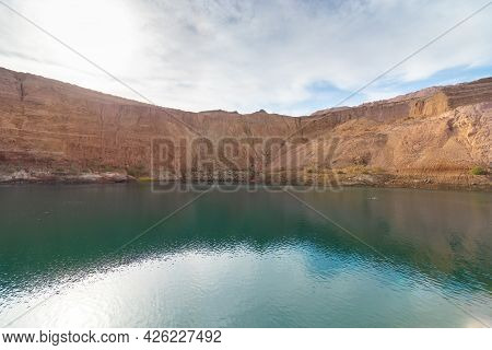 Hdr Of A Huge Crater In An Old Copper Quarry Full Of Water, In The Hidden Lake In Timna Park, Southe