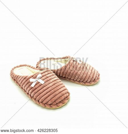 Warm Women's Home Slippers. Made Of Pink Fluted Plush. Decorated With Bows. Isolated Over White Back