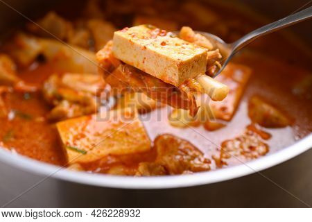 Kimchi Soup With Tofu And Pork Cooking In Pot And Eating By Spoon, Korean Food