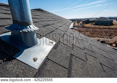 Flashing And Weather Sealing On Vent Chimney On A Shingle Roof