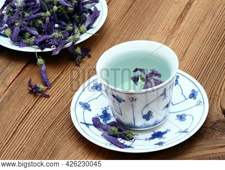 Herbal Tea From Dried Flowers Of Wild Mallow, Lat.  Malva Sylvestris. Medicinal Herb Has Been Used I