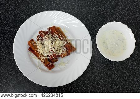 Rye Bread Croutons With Cheese, Garlic And Sauce. Top View