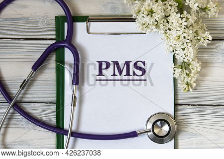 Pms (premenstrual Syndrome) - Acronym On A White Sheet With A Gentle Lilac And A Stethoscope. Medica