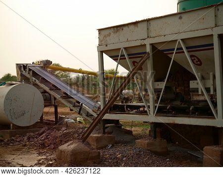 Concrete Mixer Machine Conveyer Belt Chamber Presenting Around Sky Industrial Background.