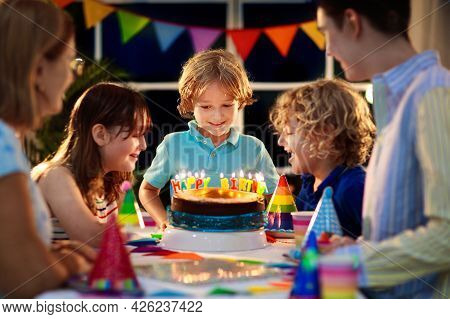 Child Birthday Party Cake. Family With Kids.