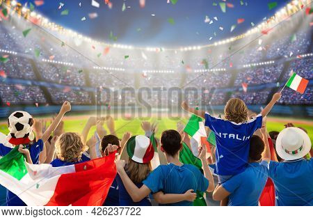 Italy Football Supporter On Stadium. Italian Fans On Soccer Pitch Watching Team Play. Group Of Suppo