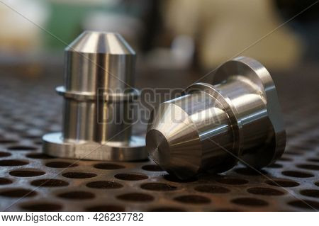A New Cnc Shaft After Machining On The Lathe And Cnc Milling Machine Lies On The Floor.