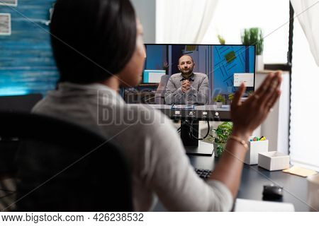 African American Woman Using University Elearning Platform Discussing With Remote Colleague During O