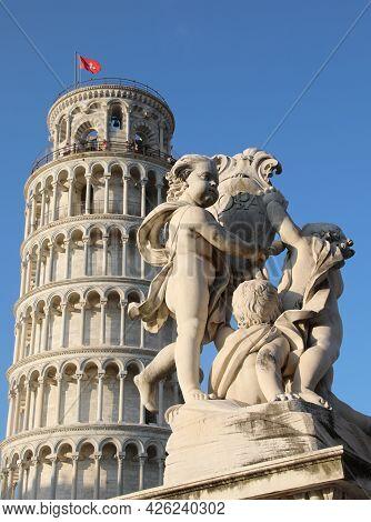Pisa, Pi, Italy - August 21, 2019: Tower Of Pisa And Statues Of Cherubs