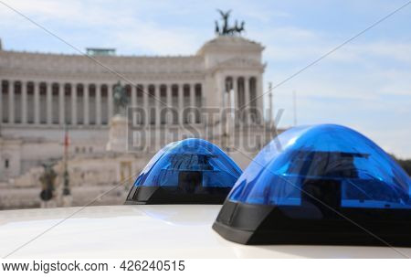 Rome, Rm, Italy - August 18, 2020: Blue Sirens Of Police And Ancient Monumento Called Altare Della P