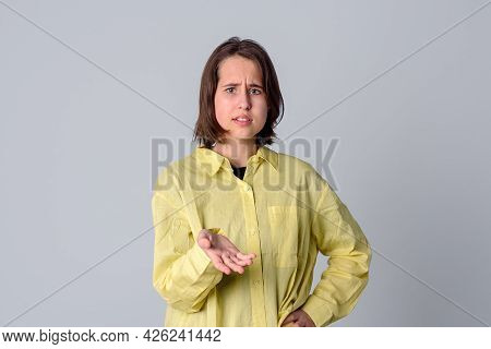 Portrait Of Displeased Pissed Teen Girl, Standing In Angry Pose, Shaking Hands And Gesturing, Being