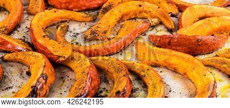 Baked Pumpkin Slices Cut Into Slices On Parchment - Close-up, Panoramic View