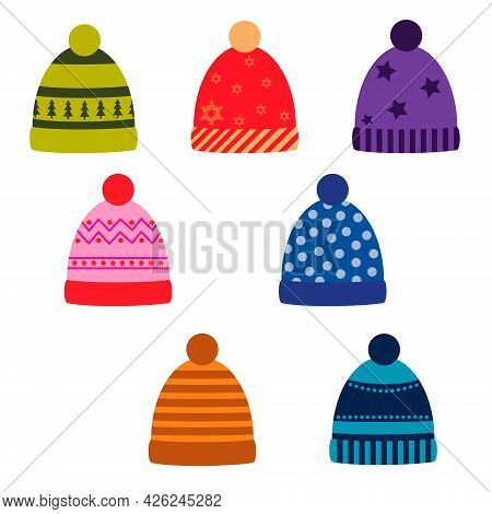 A Set Of Winter Colored Hats With A Pattern. Vector Isolated On A White Background