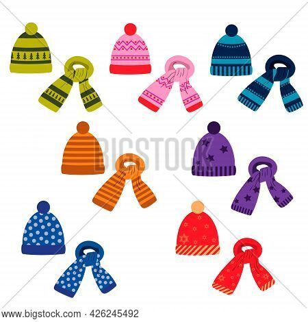 A Set Of Winter Colored Scarves And Hats With A Pattern. Vector Isolated On A White Background
