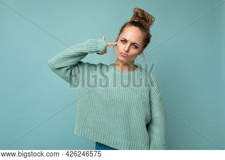 Portrait Of Young Sad Sorrowful Emotional Attractive Blonde Woman With Sincere Emotions Wearing Casu