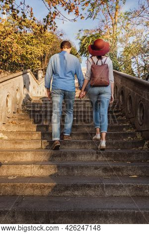 A Beautiful Young Tourist Couple Are Walking Up Stairs And Looking Around The Castle Of Buda In Buda