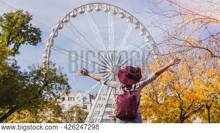 A Happy Young Woman Stop Near The Budapest Eye Big Ferris Wheel In Budapest, Hungary