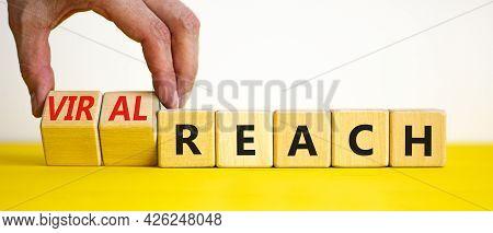 Viral Reach Symbol. Businessman Turns Wooden Cubes And Changes Words 'reach' To 'viral Reach'. Beaut