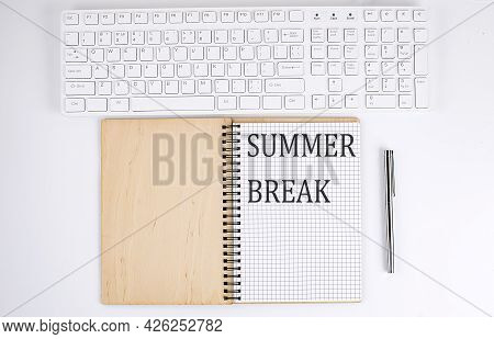 Summer Break Text On The Notebook With Keyboard On The White Background