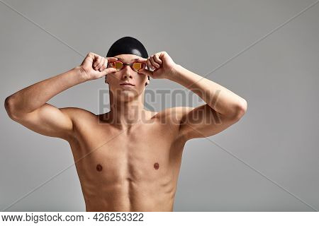 Portrait Of A Swimmer In A Cap And Mask, Half-length Portrait, Young Athlete Swimmer Wearing A Cap A