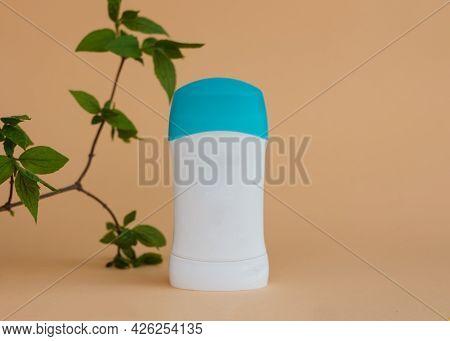 Deodorant Antiperspirant For Women For Skin Care And Good Odor On Beige Background.