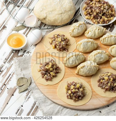 Cooking Process. Dumplings Stuffed With Minced Meat And Cheese. Convenience Food. Raw Dough Slices W