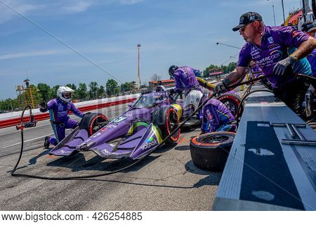 July 04, 2021 - Lexington, Ohio, USA: ROMAIN GROSJEAN (R) (51) of Geneva, Switzerland brings his car in for service during the Honda Indy 200 at Mid-Ohio at Mid Ohio Sports Car Course