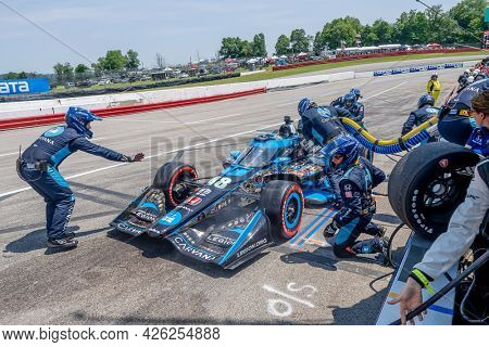 July 04, 2021 - Lexington, Ohio, USA: JIMMIE JOHNSON (R) (48) of The United States brings his car in for service during the Honda Indy 200 at Mid-Ohio at Mid Ohio Sports Car Course in Lexington Ohio.
